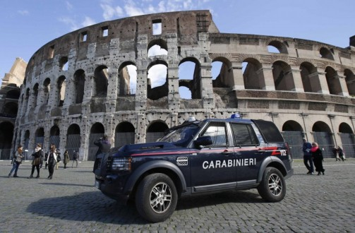 Carabinieri paramilitary car patrols in front of the Colosseum in Rome on Feb. 17.  (Max Rossi/Reuters)
